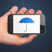 Privacy concept: Umbrella on smartphone — Stock Photo