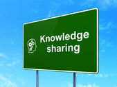 Education concept: Knowledge Sharing and Head With Gears on road sign background — Stok fotoğraf