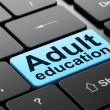 Education concept: Adult Education on computer keyboard background — Stock Photo #38240917