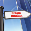 Finance concept: sign Crowd Funding on Building background — Stock Photo #38243015