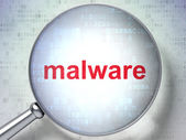 Privacy concept: Malware with optical glass — Stock Photo