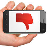 Social network concept: Thumb Down on smartphone — Stock Photo