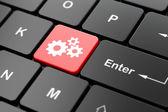 Web development concept: Gears on computer keyboard background — Fotografia Stock