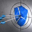 Stock Photo: Security concept: arrows in Broken Shield target on wall background