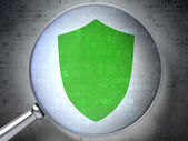 Safety concept: Shield with optical glass on digital background — Stock Photo
