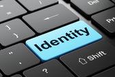 Emniyet konsepti: bilgisayar klavye arka planı üzerinde kimliğini — Stok fotoğraf