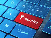 Security concept: Key and Identity on computer keyboard background — Stock Photo