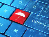 Security concept: Umbrella on computer keyboard background — Stock Photo