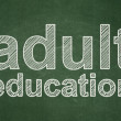 Education concept: Adult Education on chalkboard background — Stock Photo #38349557