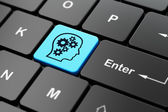 Education concept: Head With Gears on computer keyboard background — Stock Photo