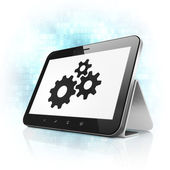 Information concept: Gears on tablet pc computer — Stock Photo