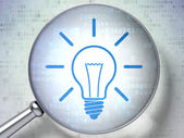 Finance concept: Light Bulb with optical glass on digital background — Stock Photo