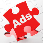 Marketing concept: Ads on puzzle background — Stockfoto