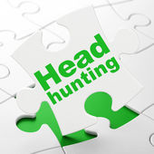 Business concept: Head Hunting on puzzle background — Stock Photo