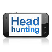 Finance concept: Head Hunting on smartphone — Stok fotoğraf