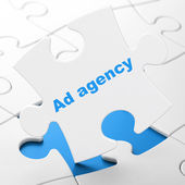 Advertising concept: Ad Agency on puzzle background — Stockfoto