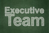 Finance concept: Executive Team on chalkboard background — Stock Photo