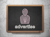 Marketing concept: Business Man and Advertise on chalkboard background — Stock Photo