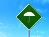 Privacy concept: Umbrella on road sign background — Stock Photo