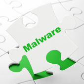 Security concept: Malware on puzzle background — Stock Photo