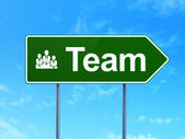 Finance concept: Team and Business Team on road sign background — Stock Photo
