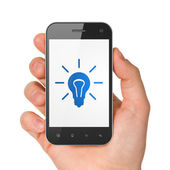 Finance concept: Light Bulb on smartphone — Foto Stock