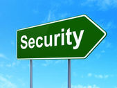 Safety concept: Security on road sign background — Stock Photo