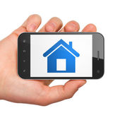 Protection concept: Home on smartphone — Stock Photo