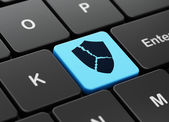 Privacy concept: Broken Shield on computer keyboard background — Stock Photo