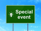Finance concept: Special Event and Light Bulb on road sign background — Stock Photo