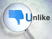 Social network concept: Thumb Down and Unlike with optical glass — Stock Photo