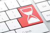 Timeline concept: Hourglass on computer keyboard background — Stock Photo