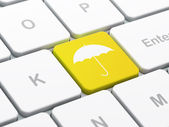Protection concept: Umbrella on computer keyboard background — Stock fotografie
