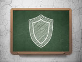 Privacy concept: Shield on chalkboard background — 图库照片