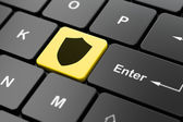 Safety concept: Shield on computer keyboard background — Stock fotografie