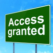 Stock Photo: Protection concept: Access Granted on road sign background
