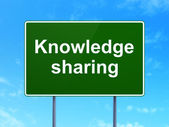 Education concept: Knowledge Sharing on road sign background — Stock Photo