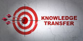 Education concept: target and Knowledge Transfer on wall background — Stock Photo
