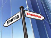 Education concept: sign Knowledge Sharing on Building background — Stock Photo