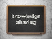 Education concept: Knowledge Sharing on chalkboard background — Stock Photo