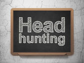 Business concept: Head Hunting on chalkboard background — Photo