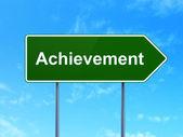 Education concept: Achievement on road sign background — Foto de Stock