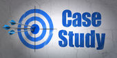 Education concept: target and Case Study on wall background — Foto de Stock