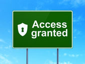 Privacy concept: Access Granted and Shield With Keyhole on road sign background — Stock Photo