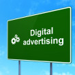 Advertising concept: Digital Advertising and Gears on road sign background — Stock Photo