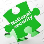 Ochranu koncept: národní bezpečnost na pozadí puzzle — Stock fotografie