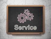 Business concept: Gears and Service on chalkboard background — Stock Photo