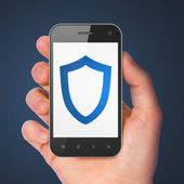 Safety concept: Contoured Shield on smartphone — Stock Photo