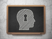 Education concept: Head With Keyhole on chalkboard background — Stock Photo