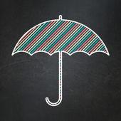 Safety concept: Umbrella on chalkboard background — Stock Photo